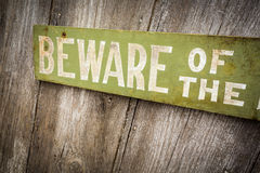 Beware Of Dog Sign on Old Worn Wood Fence Stock Images