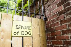 Dangerous Dog Sign. Warning sign to alert people dogs are on premises liability protection for dog owners words beware of dog Royalty Free Stock Images