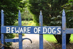 Beware Of Dogs. A sign on gate warning of dogs Stock Image