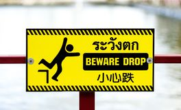 Beware drop sign stock photography