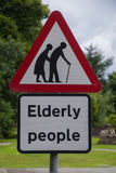Beware of elderly people. Road sign warning of elderly people royalty free stock photo