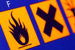 Beware flammable. Warning signs on the product packaging- caution flammable,harmful substance stock photos