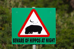 Beware of Hippos at night  sign Royalty Free Stock Images