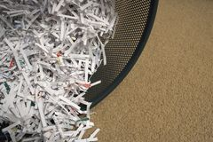Beware of identity theft. Close-up of cross-cut shreds royalty free stock photography