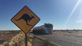 Beware of the kangaroo road sign on Stuart highway in central Australia outba