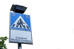 Caution student crossing. Beware of people or children crossing the street in school zone, Road symbol signs and traffic symbols for roadway, blue board with royalty free stock photos