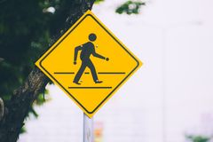 Beware people single man cross the road traffic sign. Yellow color on the street with space for text Royalty Free Stock Photography