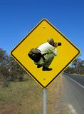 Beware of photographers. Caution photographers ahead. Funny road sign agains the blue sky Stock Images
