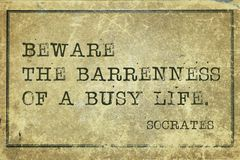 Beware-print. Beware the bareness of busy life - ancient Greek philosopher Socrates quote printed on grunge vintage cardboard royalty free stock photography
