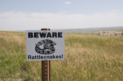 Beware rattlesnakes sign Stock Photo