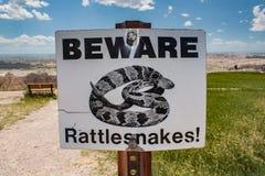 BEWARE rattlesnakes sign in South Dakota badlands Royalty Free Stock Images