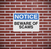 Beware of Scams. A modified notice sign warning about scams Royalty Free Stock Photo