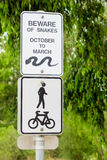Beware of Snakes Sign. On an exercise track Stock Photography