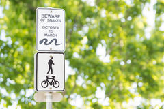 Beware of Snakes Sign. A beware of snakes sign on an exercise path in Australia Stock Photo