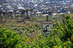 Beware snakes sign post in the bushes of Capetown, South Africa Stock Photo
