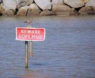 Beware soft mud sign stock photo