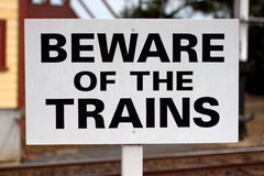 Beware of the trains. Heritage Beware of the trains warning sign, next to rails stock images