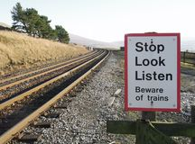 Beware trains at Dent Station. A sign at the end of the platform at Dent railway station, Cumbria, UK Stock Image