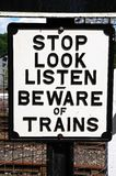 Beware of trains sign. Stock Photos