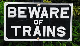 Beware of trains sign. Old fashioned rectangular Beware of Trains sign, Hampton Loade, Shropshire, England, UK, Western Europe royalty free stock photos