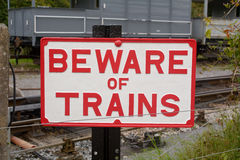 Beware of Trains sign at Railway Station Stock Photo