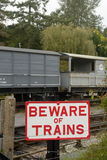 Beware of Trains sign at Railway Station Royalty Free Stock Photos