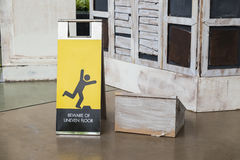 Beware uneven floor sign Stock Photography