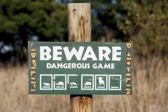 Beware van Gevaarlijk Spel stock foto