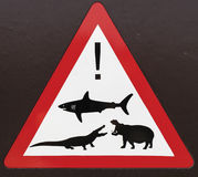 Beware of Wildlife. Indication board showing some dangerous animals in the area (sharks, crocodiles and hippos), South Africa Stock Photo