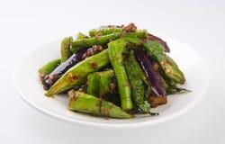 Beweeg gebraden lange bonen, het Aziatische voedsel van damefignures Stock Foto