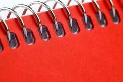 Beweeg notitieboekje spiraalsgewijs stock fotografie