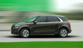 Bewegende bruine auto royalty-vrije stock foto