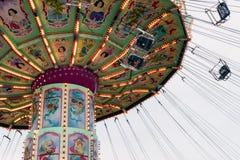 Bewegende Luftikus-carrousel, Prater, Wenen, Oostenrijk, donkere dag Royalty-vrije Stock Foto