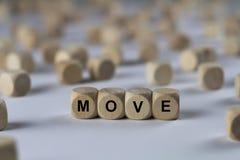 Beweging - kubus met brieven, teken met houten kubussen royalty-vrije stock foto