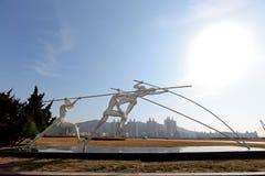 Beweging van het Xinghai de vierkante beeldhouwwerk Stock Fotografie