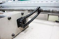 Bewegungskettenantriebsachse in der Fördererlinie Stockfotos