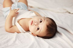 Bewildered baby. Portrait looking upward, isolated against white background Royalty Free Stock Photography
