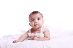 Bewildered baby wearing frock Royalty Free Stock Images