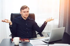 Bewildered businessman throwing up his hands Royalty Free Stock Photos