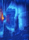 Bewitched forest in blue. Abstraction of a scene in the wood held in various blue tone.Light streaming into the darkness of the wood. Variations of blue give the Stock Photos