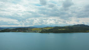 Bewitching Horizontal Panorama of Lake, Mountains, Village, Sky and Clouds stock video