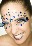 Bewjeled Woman. Woman smiling with jewels on face Stock Photo