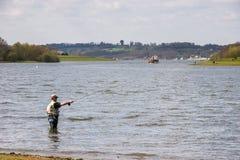 BEWL WATER RESERVOIR, LAMBERHURST/KENT - APRIL 10 : Fly fishing royalty free stock image