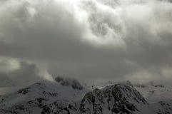 Bewolkte Alpen Stock Foto's