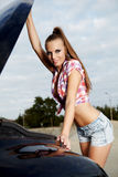 Bewoman repairing the car Stock Photography