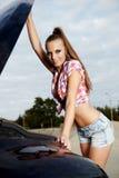 Bewoman repairing the car Stock Photography