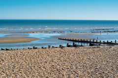 Bexhill sur la plage de mer dans la marée basse Photographie stock libre de droits