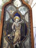 Bey Old Stained Glass Window. Vey old leaded stained glass window displays a beautiful angel royalty free stock image