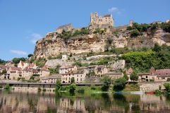 Beynac from Dordogne. The Chateau de Beynac  towers over the town of Beynac which clings to the rocks in a bend of the Dordogne river, France Royalty Free Stock Image