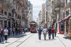 Beyoglu Istanbul Turkey. Pedestrians and a tram on a typical street of Beyoglu, Istanbul, Turkey stock images